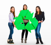 Three people holding a recycle sign Stock Image