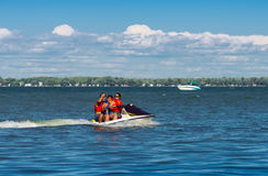 Three people on a jet ski Royalty Free Stock Image
