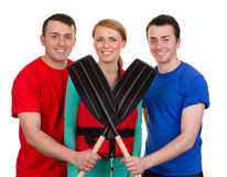 Three people with oars Stock Images