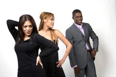 Three People Posing. Two girls and a guy posing over white background Stock Photos