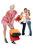Three people with shopping bags Stock Photos