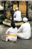 Three people prying at Goa Gajah temple Royalty Free Stock Image