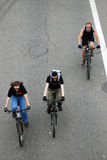 Three people ride bikes. View from above. Stock Photos