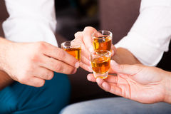 Three people with rum shots. Three men with rum shots stock photography
