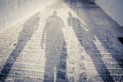 Three people shadows. On the street with vintage look Royalty Free Stock Photo