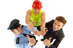 Three people shows thumbs up Royalty Free Stock Photo
