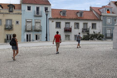 Three people sightseeing around Lisbon. Portugal Royalty Free Stock Photos