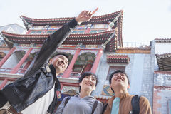 Three people sightseeing, looking and pointing. Royalty Free Stock Photography