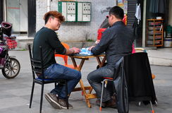 Pengzhou, China: Men Playing Mahjong Stock Photo