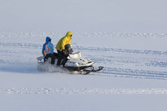 Three people on snowmobile Royalty Free Stock Images