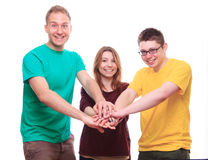 Three people team keeps on with your hands Stock Image