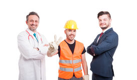 Three people and their different occupations. Standing with crossed arms and smiling while builder doing peace sign on white background Stock Photo