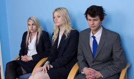 Three people waiting Royalty Free Stock Photography