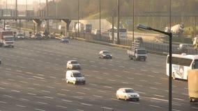 Three people walking between traffic on motorway - timelapse stock video footage
