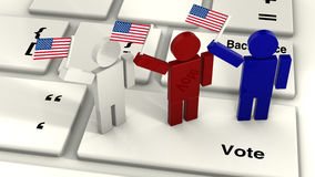 Three people waving the american flag on a vote key of a compute Royalty Free Stock Photography