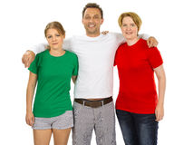 Three people wearing green white and red blank shirts. Photo of three people wearing green, white, and red blank t-shirts as the colours of the flag of Italy Royalty Free Stock Photos
