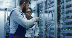 Three people working in a data center