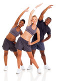 Three people workout Royalty Free Stock Photo