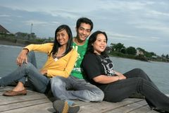 Three peoples. Photograph of three peoples on pier at evening Royalty Free Stock Images