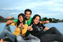 Three peoples with tumb up. Photograph of three peoples with tumb up stock photography