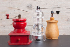 Three pepper mills Stock Photos