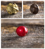Three peppercorns Stock Images