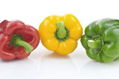 Three Peppers. Multi Colored Isolated On White Background Close Up royalty free stock image