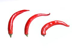 Three peppers. Isolated over white Royalty Free Stock Photo