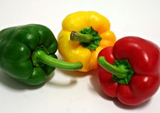 Three Peppers. Red, yellow and green pepper Royalty Free Stock Image