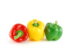 Three peppers. On the white background. Green, red, and tellow stock photos