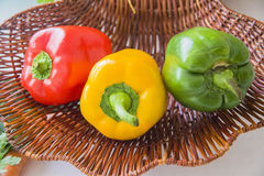 Three peppers only in basket Stock Images