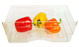 Three peppers in a  box. Stock Photos