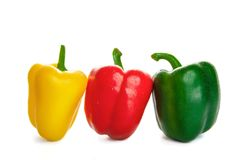 Three peppers in the droplets of water. on a white background Royalty Free Stock Photo