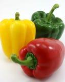 Three peppers green, yellow, red organic. Three peppers green, yellow, red on white background Stock Photo