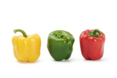 Three peppers, red, green, yellow Stock Images
