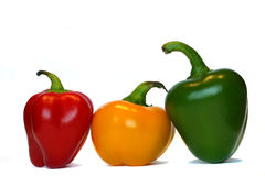 Three peppers in a row Stock Images