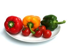 Three peppers and some tomatoes Stock Photo