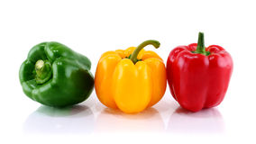 Three peppers  on white background Royalty Free Stock Photos