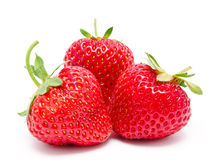 Three perfect red ripe strawberry isolated Stock Photos