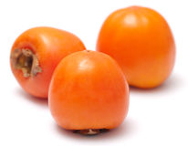 The three persimmon. Insulated on a white background Stock Images