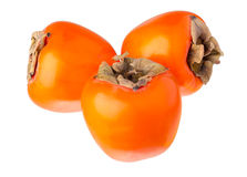 Three persimmon. Stock Photos