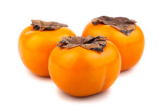 Three persimmon fruits Stock Photo