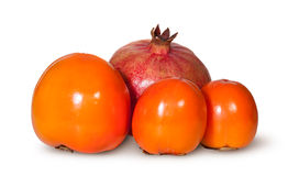 Three Persimmon And One Pomegranate Fruit Royalty Free Stock Images
