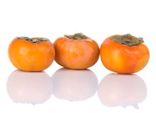 Three Persimmons Stock Photo