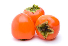 Three persimmons Royalty Free Stock Image