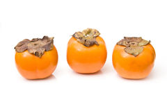 Three Persimmons On White Royalty Free Stock Photos