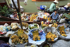 Three person selling fruits and food at Damonen Saduak floating market Stock Photos