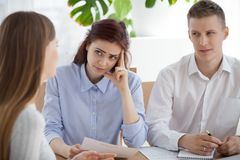 Three person sitting at the desk in office during interview royalty free stock photos