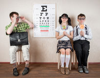 Three person wearing spectacles in an office at the doctor Royalty Free Stock Photography