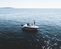 Three Person on White Motorboat at Daytime Royalty Free Stock Photos